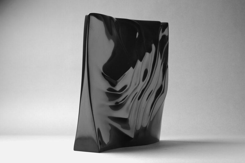 Imprint, marmo Nero Belgio, anno 2007, 50x50x12